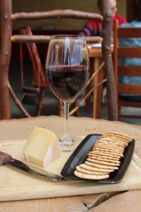 Tomae hard sheep's cheese, water crackers, and a more than generous glass of Syrah.