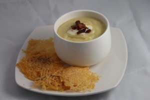 Potato Leek Soup with Creme Fresh, Wild Boar Bacon Lardons, and Parmesan Crisps